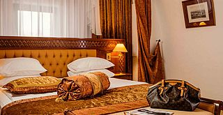 Luxury Suite Bedroom - Citadel Inn Hotel & Resort